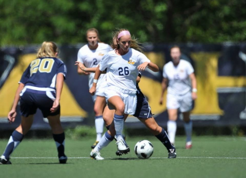 Claire haft playing soccer at GW