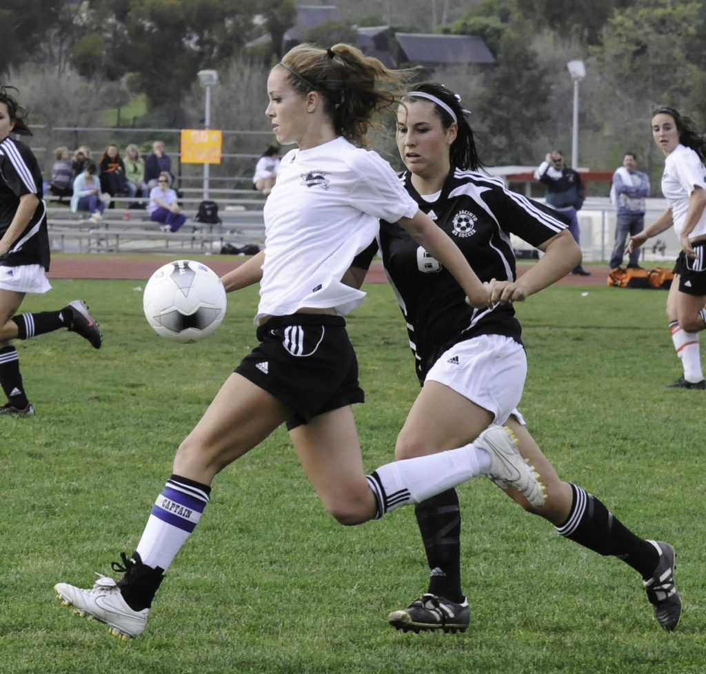 Claire haft playing high school soccer